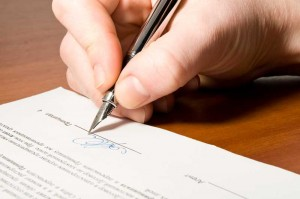 Signing a Contract - Nashville TN - East End Chiropractic